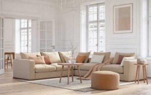 decorar un sofá beige con cojines