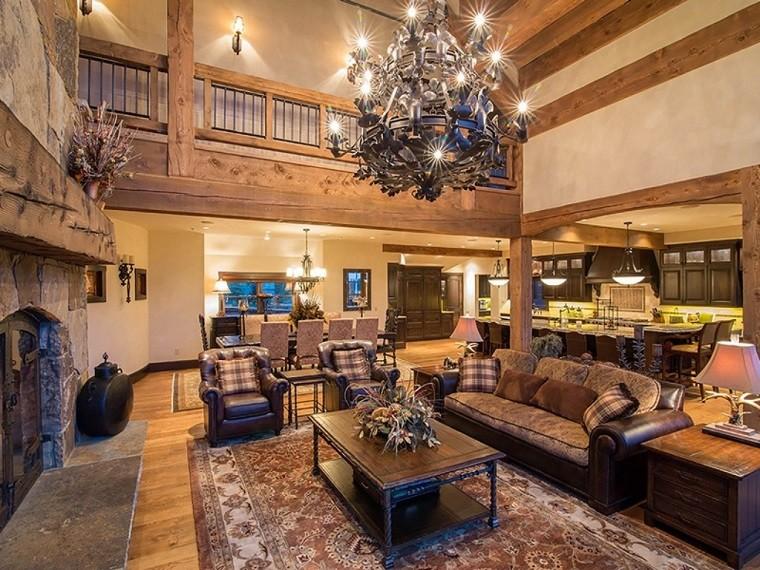Salón con sofás marrones y toque rústico