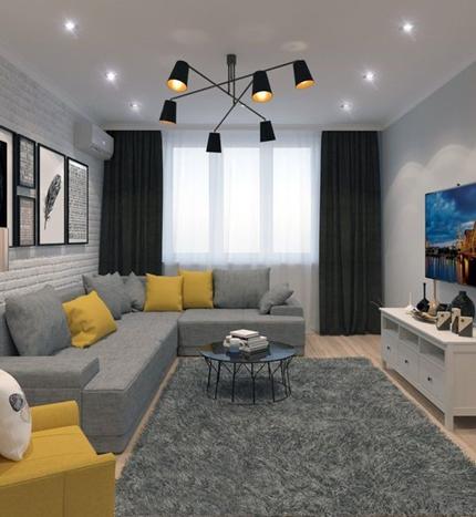 Cojines amarillos y grises en un sofá gris