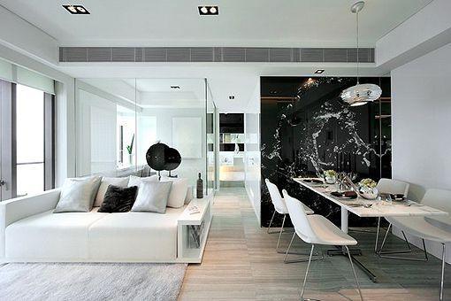 salon comedor blanco y negro con líneas rectas