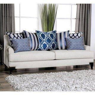 Un toque de azul elegante con cojines para tu sofá gris claro
