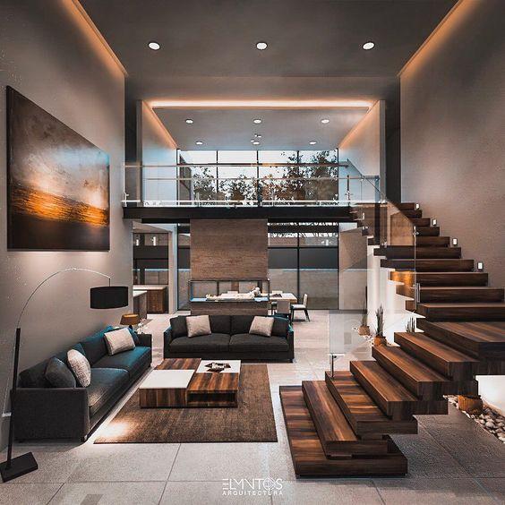 Salones amplios y colores intensos grises y de madera