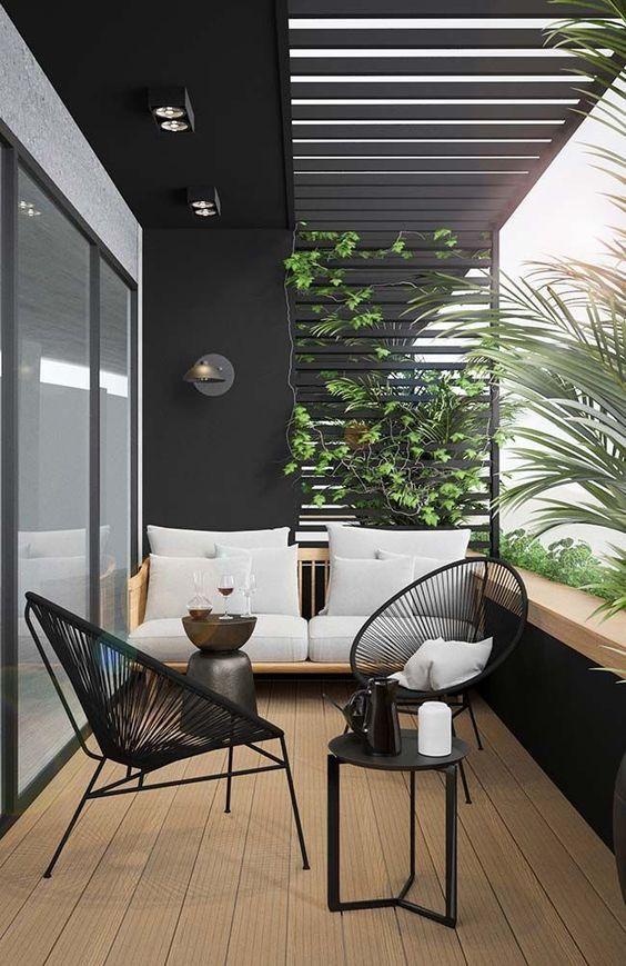 Decoraciones de balcon moderno en negro para un espacio de tendencia