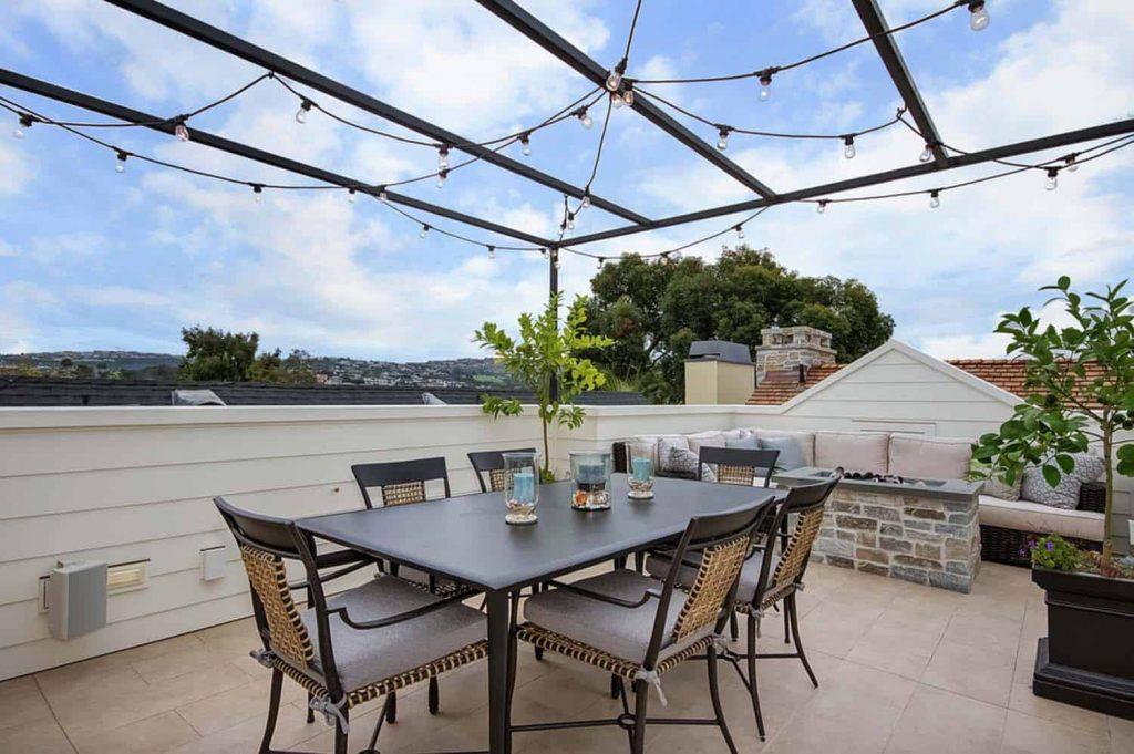 Terraza para el ático con mesa de comedor