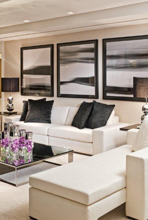 cojines Negros Siempre Serán una Buena Opción par un sofá blanco