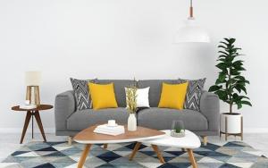sofa gris cojines mostaza