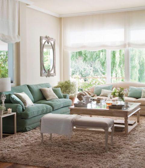 Cojines para sofá verde con colores neutros