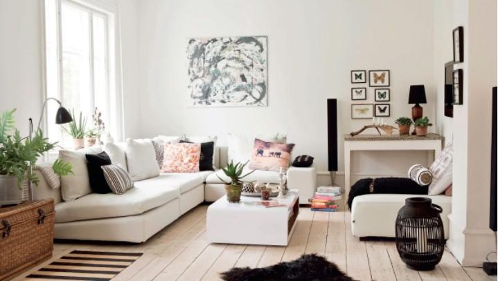 Decoración nórdica en salón con muebles blancos