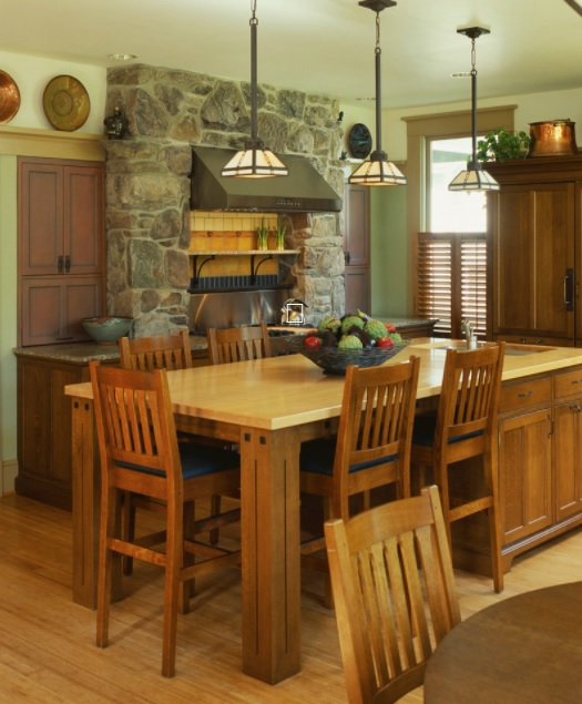 cocina elegante y artesanal con pared de piedra
