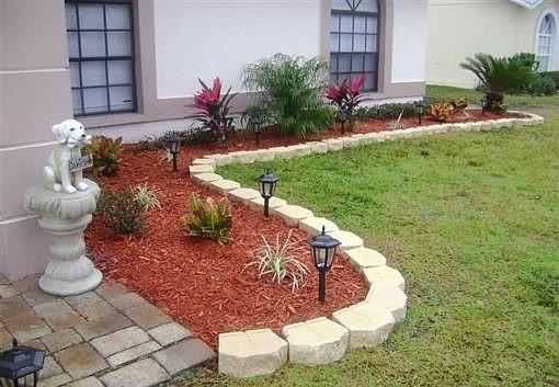 decoración de jardines con mulch y farolillos