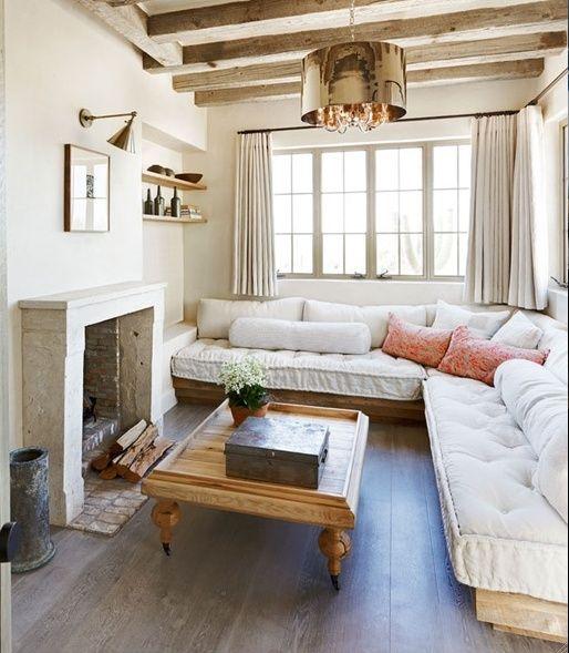 Salón Rústico y pequeño con Piedras y Blanco