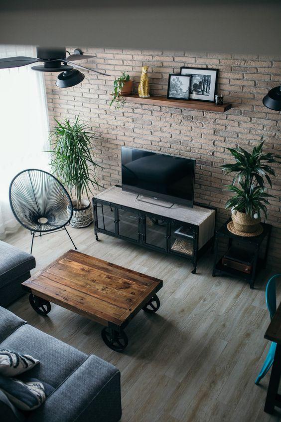 salón estilo industrial con muebles industriales