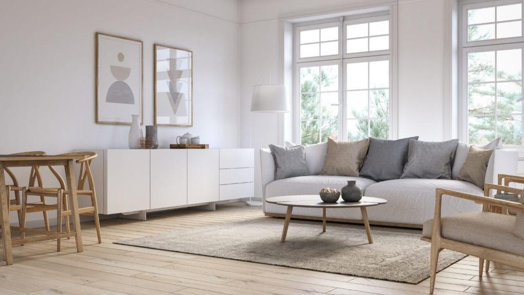 Aprovecha la luz para que tu salón blanco y gris brille con madera