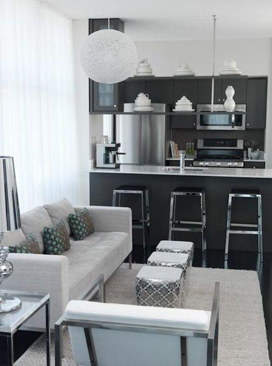 Salón con cocina americana moderna en blanco y negro