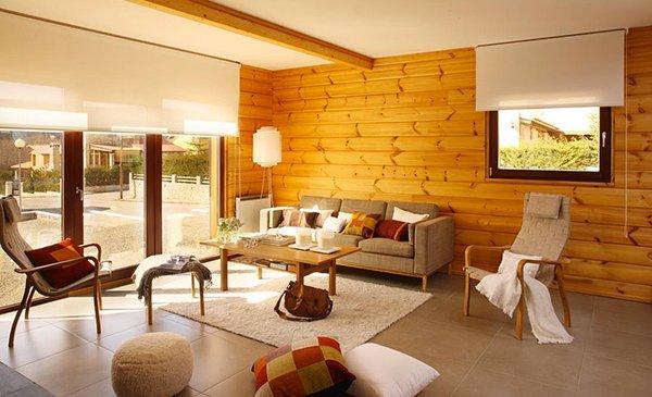 Salón con paredes de madera estilo cabaña