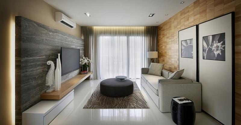 Usa luces cálidas para resaltar el gris y el blanco de tu salón