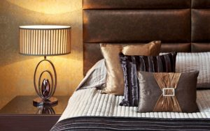 bedroom with gold cushions